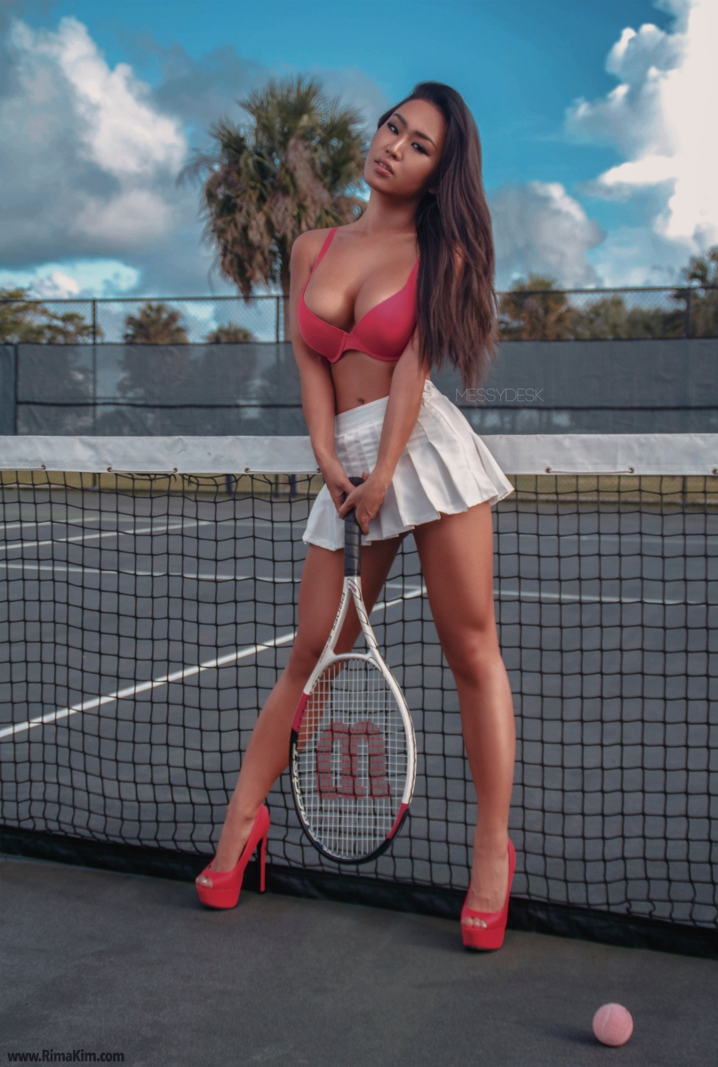 Playing tennis with heels on ;>